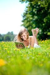 Beautiful smiling woman with tablet pc, outdoors