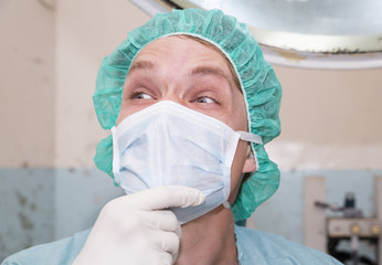 Surgeon is laughting about some joke