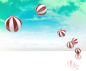 six jumping striped inflatable balls on blue cloudy sky