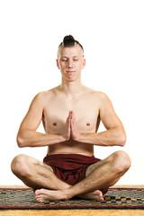young man in meditation, portrait in studio