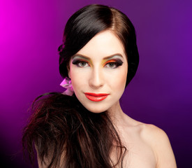 Portrait of pretty young woman with bright colorful makeup