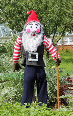 A Scarecrow Dressed as a Gardening Gnome.