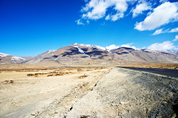 yellowish mountain road view in tibet