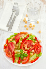 vegetable salad with chickpea on the white plate