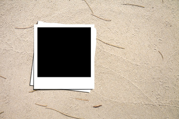 Photo paper on sand background