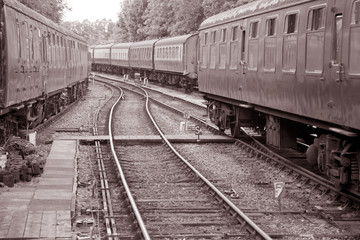 Railroad Carriages on Tracks in Black and White Sepia Tone