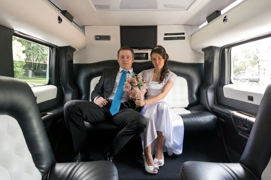 The bride and groom in limousine