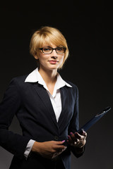 Beautiful young businesswoman with document case