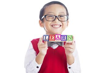 Fotobehang - Schoolboy with LEARN word