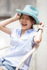 asian woman wearing a hat with smiling face