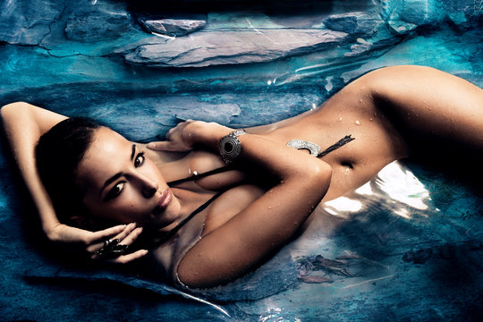 sensual woman in  natural pool
