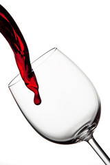 Tasty red wine poured into crystal glass