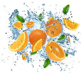 Fotobehang Opspattend water Fresh oranges in water splash on white background.