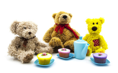 Teddy bears picnic with tea and cakes over a white background