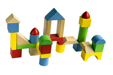 Castle built with colorful wooden toy blocks isolated