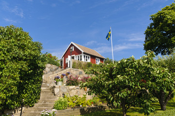 Red cottage and Swedish flag