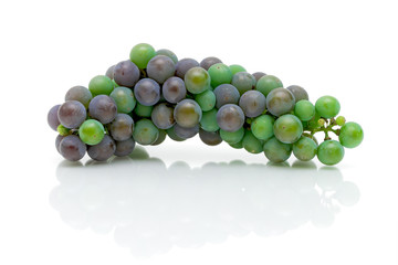 a bunch of young grapes on white background
