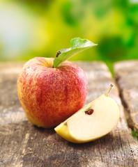 Quartered apple showing juicy flesh