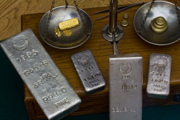 Silver Bullion Bars - Gold Bar, Nugget and Dust on Scale