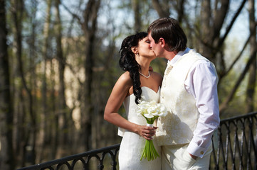 Kiss bride and groom in walking