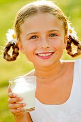 Fresh milk - lovely girl drinking fresh milk outdoors