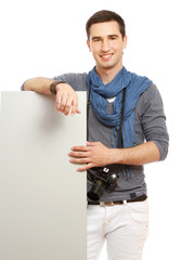 portrait of a young photographer with a camera