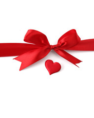 satin gift bow and red heart, isolated on white background