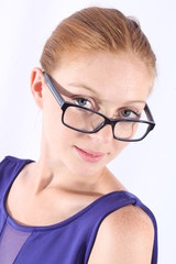 Beautiful redhead woman with eyeglasses