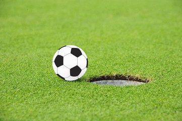 Football on Edge of Hole