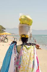 Clothes Saleswoman on the beach