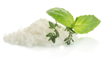 salt with fresh thyme and  basil isolated on white
