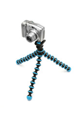 Camera on a tripod isolated on white background
