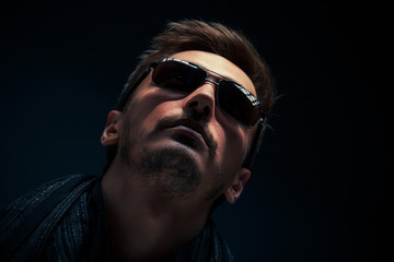 portrait of a handsome guy, wearing sunglasses, Low-key image