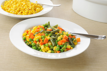 Serving dishes of vegetables