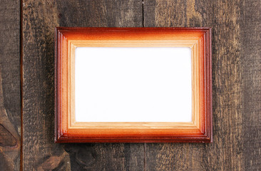 Wooden frame on wooden background