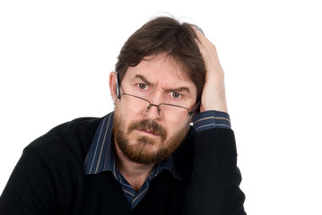 Portrait of bearded man wearing glasses about amazement looking