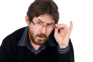 The surprised man wearing glasses fixedly looks in chamber.