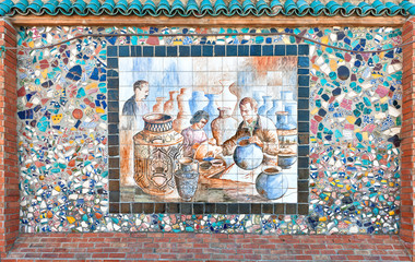 Mosaic of broken pottery and ceramics painting of artisans
