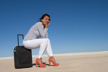 Pretty woman on holiday waiting lonely