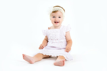 Adorable little baby girl laughing, creeping & playing in the st