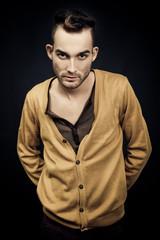 handsome elegant young fashion man on dark background