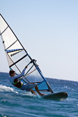 Side view of a windsurfer mooving horizontally