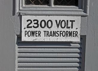 power transformator 2300 volt, text on vintage wooden signboard