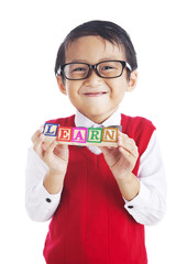 Student with letter blocks