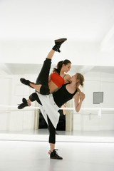two dancers show techniques of contemporary dance