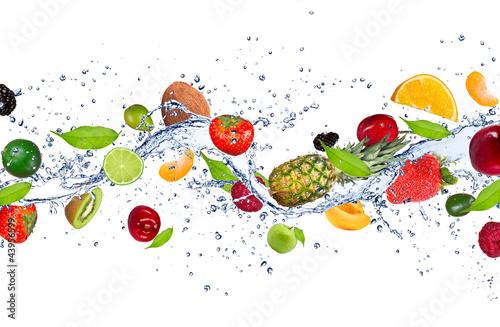 Fototapete Fresh fruits falling in water splash