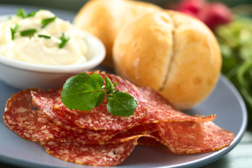 Thin salami slices with cream cheese and buns