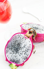 Dragon fruit cut and a beverage