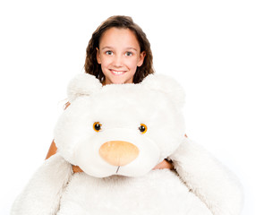 Beautiful little girl with toy bear