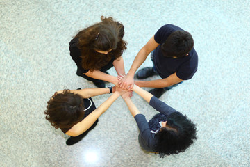 Group of people with hands together showing teamwork